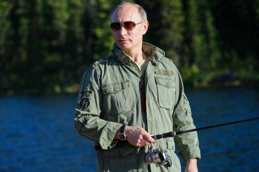 <p>Президент России Владимир Путин во время рыбалки в одном из национальных заповедников Тувы. Фото © ТАСС / Алексей Никольский</p>