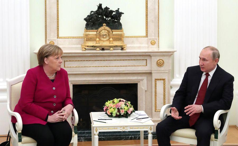 <p>Президент РФ Владимир Путин и канцлер Германии Ангела Меркель. Фото © Kremlin</p>