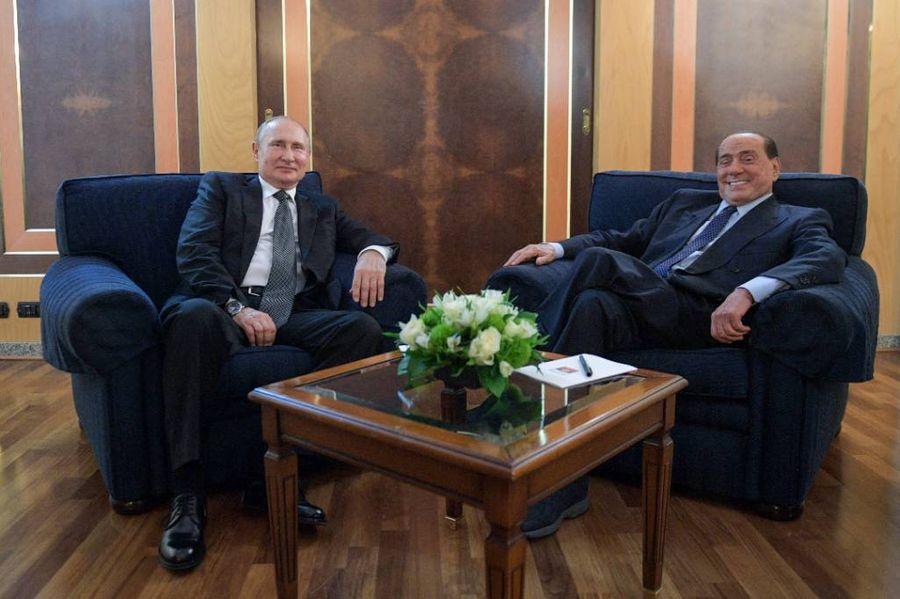 <p>Президент РФ Владимир Путин и бывший премьер-министр Италии Сильвио Берлускони. Фото © ТАСС / Алексей Дружинин</p>
