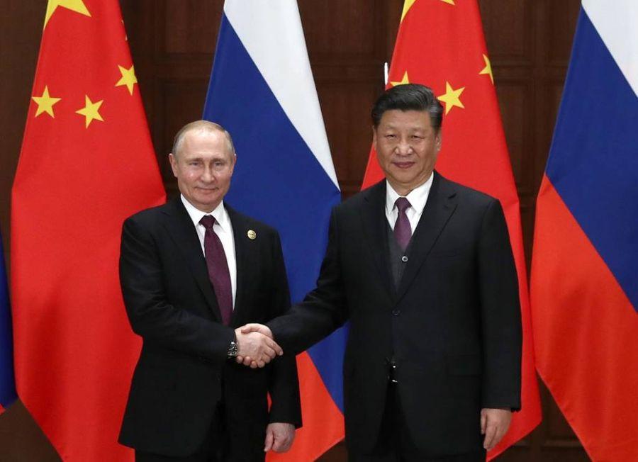 <p>Президент РФ Владимир Путин и председатель КНР Си Цзиньпин. Фото © ТАСС / Валерий Шарифулин</p>