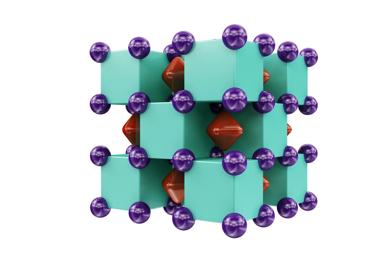 Кристаллическая структура Na2He напоминает трёхмерную шахматную доску. Пурпурные шары — атомы натрия, а внутри зелёных кубов — атомы гелия. Красные области показывают, где локализованы электронные пары. Фото:©МФТИ