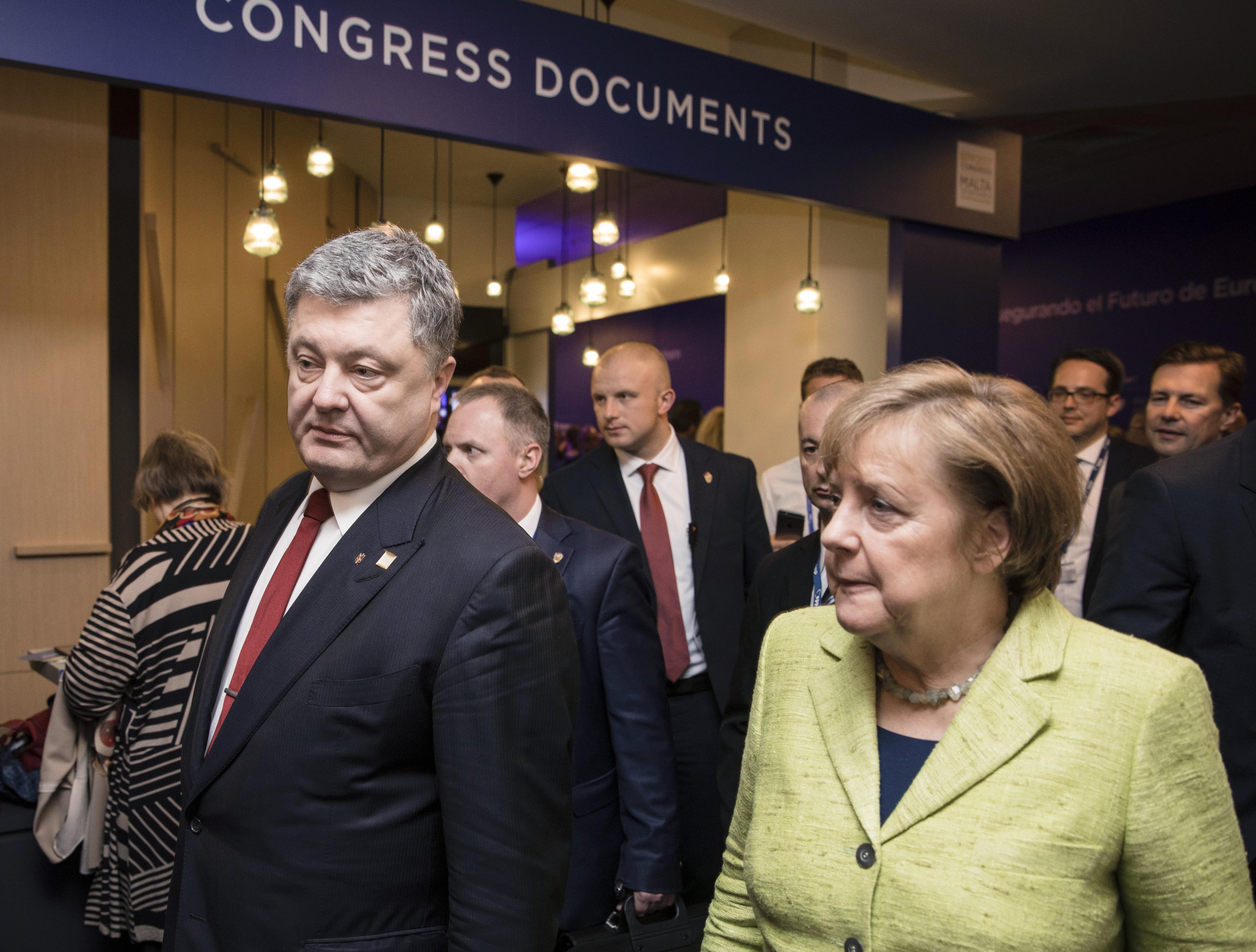 <p>Петр Порошенко и Ангела Меркель.&nbsp;Фото: &copy; РИА Новости/Михаил Палинчак</p>