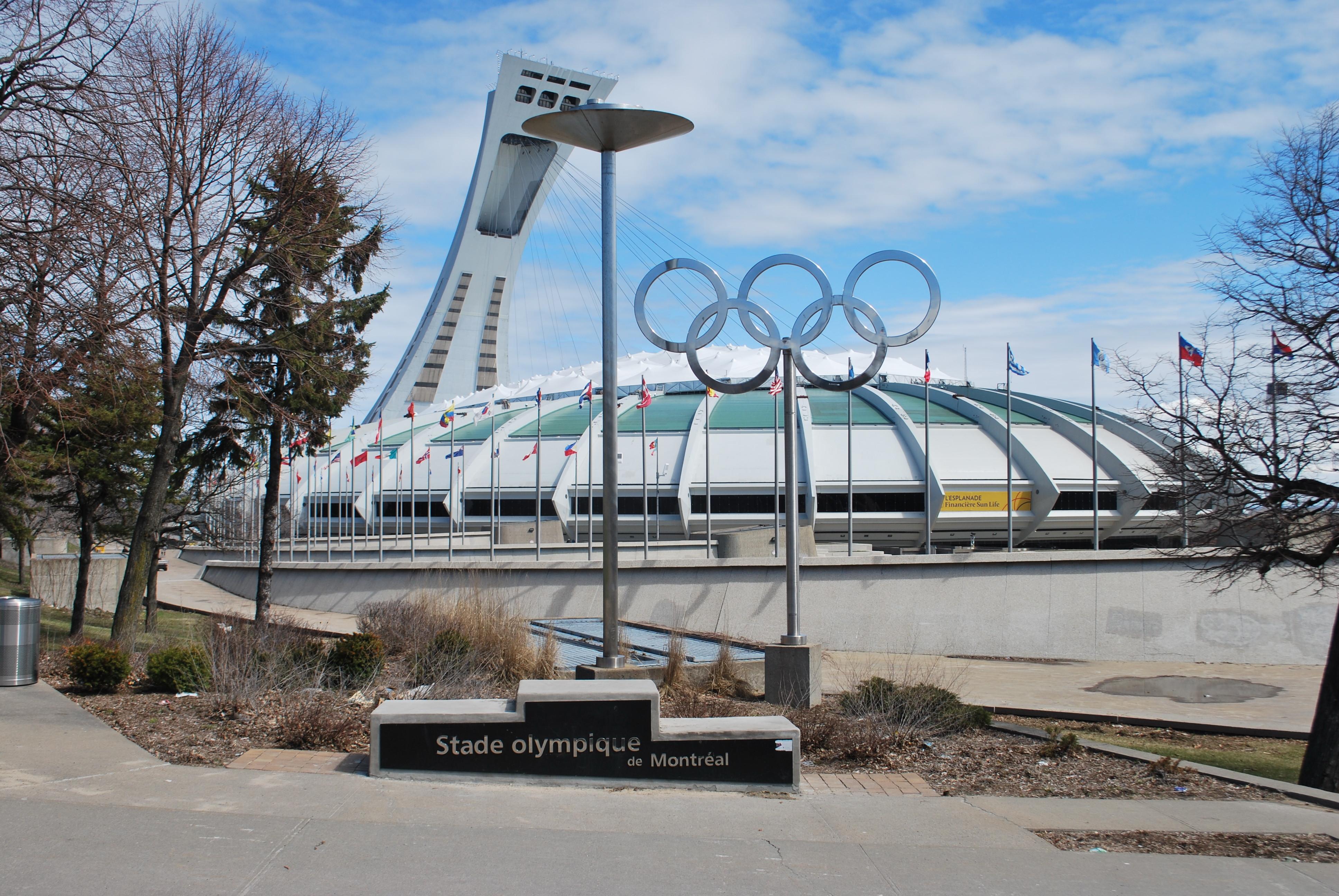 "<p>Олимпийский стадион в Монреале. Фото:&nbsp;&copy; Flickr/<a href=""https://www.flickr.com/photos/thewestend/14354611076/in/photolist-nSt8Lq-8uSEsG-5rXnic-a95m6Q-oZEBKj-2qP2j-8E5SKU-5mumnw-8E2EC2-6Ye2wC-8uWMwf-cWhi-qoB6wY-bZYDgq-WJfdeQ-5munPu-8sYRhd-5mumt1-5rXq7z-5mq7JD-8E2HKt-7VsSxW-ppD433-qCSPNy-paaT4M-5RYnLA-p2oJBF-5muhWs-prDrAy-8E2Jn4-8sVPXP-nscKPe-8E2Jbx-5mq3n8-5mq39i-8mpTvs-8E2HzM-5mq3gi-8E2JeK-5muiGf-paaT5P-fT3M4S-5mq4pV-5mq74e-5muj73-8E5SEs-8E2HwB-8E2HHr-8sYP4N-3ZnWs"">The West End</a></p>"