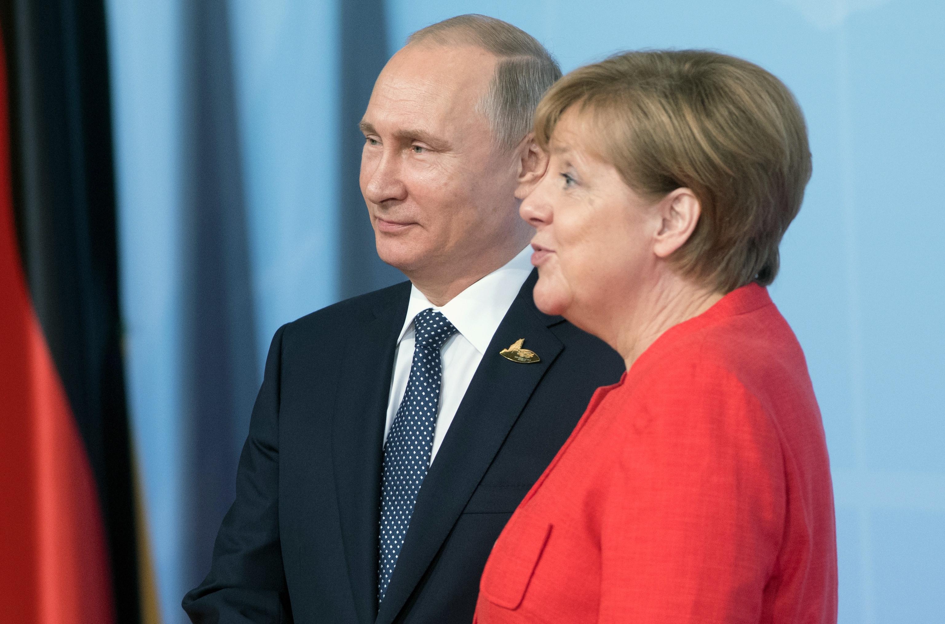 <p>Презмдент России Владимир Путин (слева) и канцлер ФРГ Ангела Меркель. Фото: &copy; РИА Новости</p>