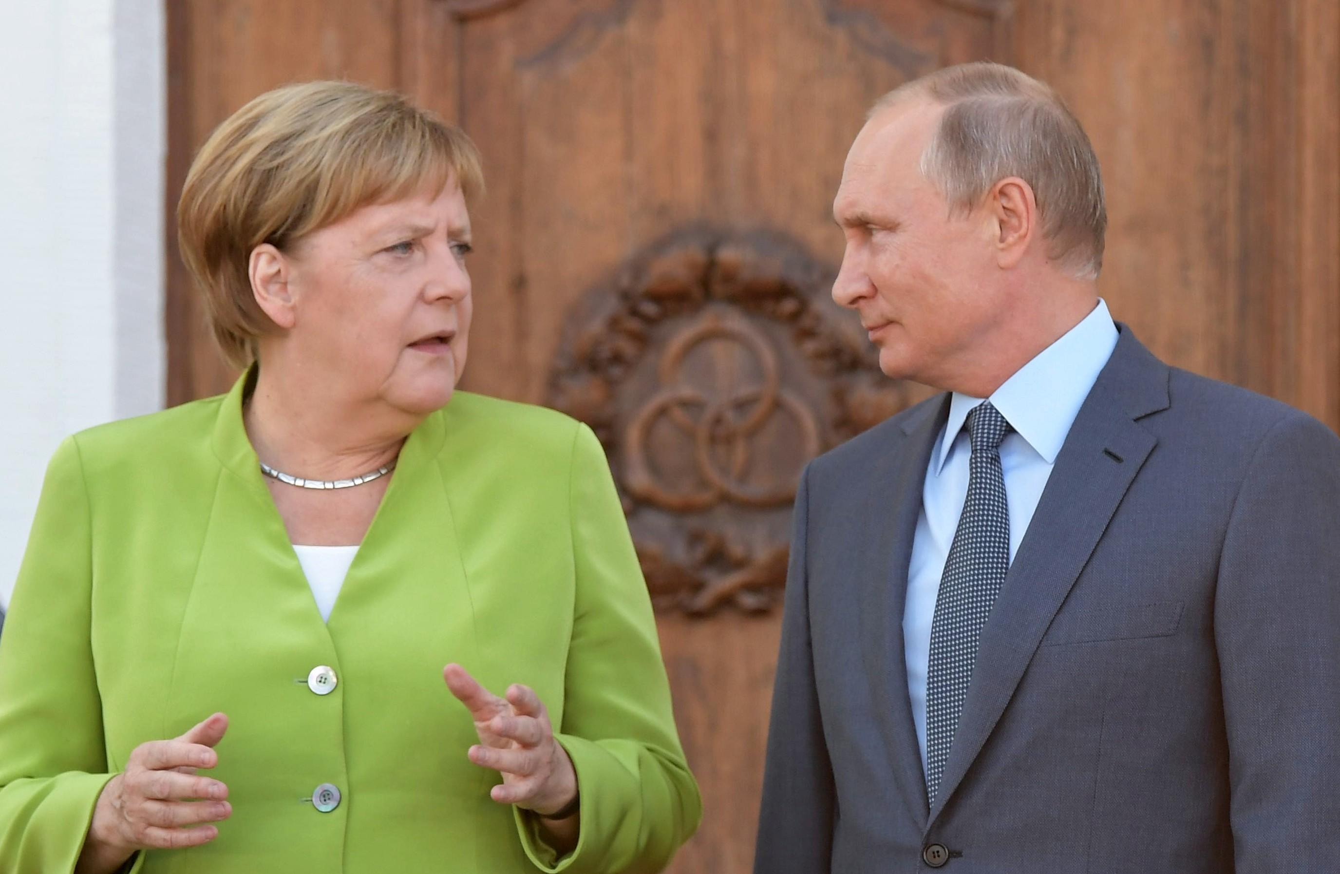 <p>Ангела Меркель и Владимир Путин. Фото: &copy;РИА Новости/Сергей Гунеев</p>