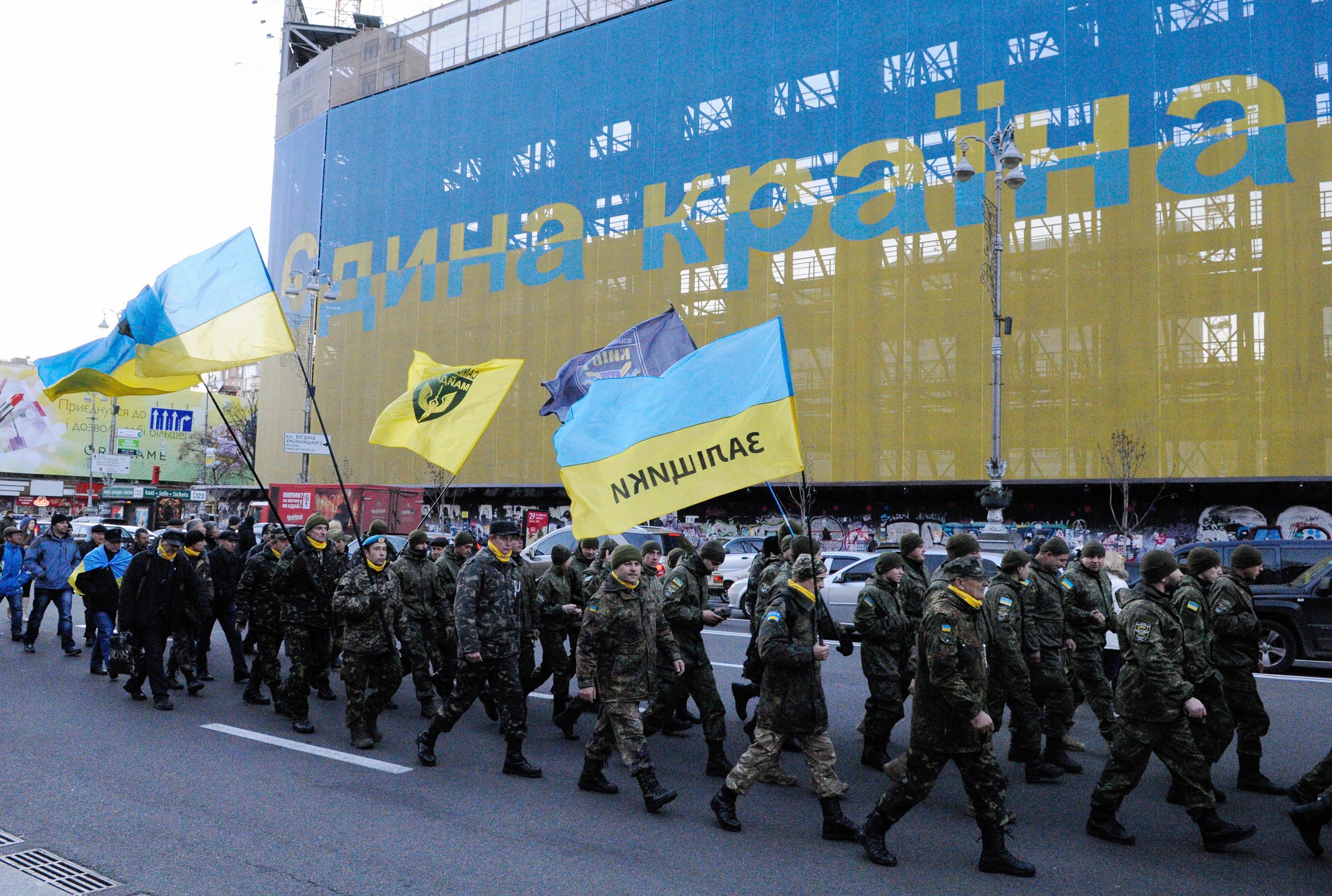 """<p>Участники """"самообороны Майдана"""" во время памятных мероприятий. Фото: &copy;РИА Новости/Александр Максименко</p>"""