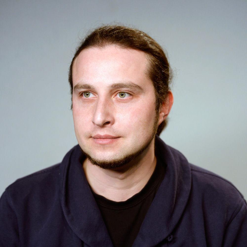 Александр Юнашев