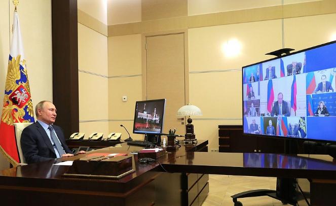 "<p>Президент Владимир Путин на совещании в режиме видеоконференции.</p><p>Фото © <a href=""http://kremlin.ru/events/president/news/64985"" target=""_blank"" rel=""noopener noreferrer"">Kremlin.ru </a></p>"