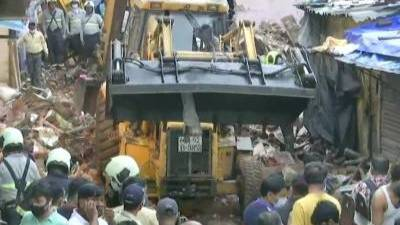 """<p>Фото © <a href=""""https://www.timesnownews.com/mumbai/article/mumbai-9-dead-8-injured-as-residential-building-collapses-in-malad-west-search-rescue-operation-underway/768533"""" target=""""_blank"""" rel=""""noopener noreferrer"""">timesnownews</a></p>"""