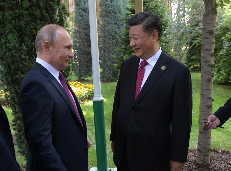 "<p>Владимир Путин и Си Цзиньпин. Фото © <a href=""http://kremlin.ru/events/president/news/60757/photos/59554"" target=""_blank"" rel=""noopener noreferrer"">Kremlin.ru</a></p>"