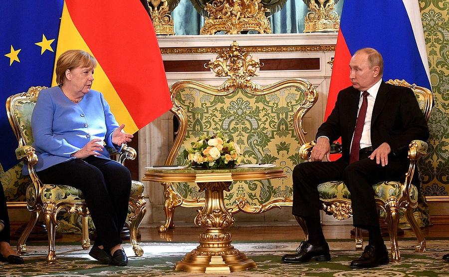 """<p>Владимир Путин и Ангела Меркель. Фото © <a href=""""http://www.kremlin.ru/events/president/news/66414"""" target=""""_blank"""" rel=""""noopener noreferrer"""">Kremlin.ru</a></p>"""