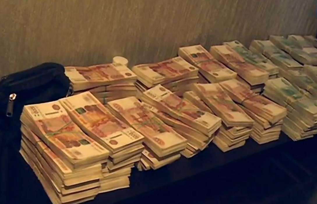 Пачки денег секты. Фото © rybinsk-once.ru