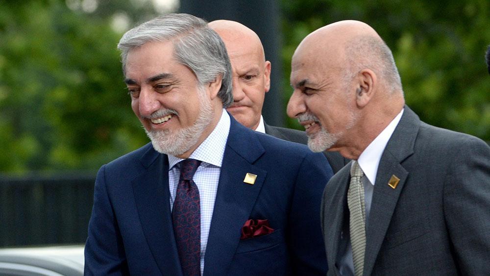<p>Абдулла Абдулла и Ашраф Гани. Фото © ТАСС / EPA / JACEK TURCZYK</p>